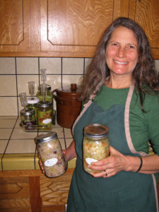 Beth Love holding jars of homemade sauerkraut
